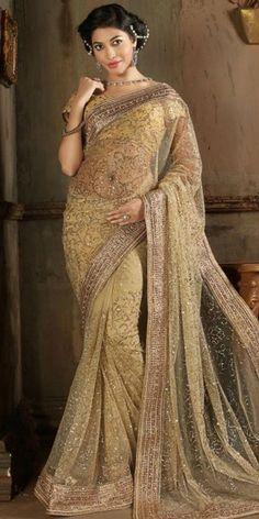 Charming Embroidered Pallu Saree in Cream Color.