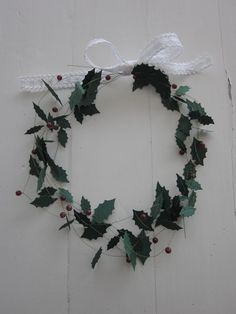 Holly leaves paper garland strung on thin metal wire