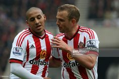Lee Cattermole (R) of Sunderland talks with team-mate Wahbi Khazri during the Barclays Premier League match between Sunderland and Chelsea at the Stadium of Light on May 7, 2016 in Sunderland, England.