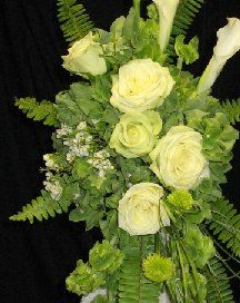 Create a Bouquet in Green Roses - Step by step tutorial for cascading bouquet.  List of products needed - find all the professional florist supplies in one place.  Bouquet holders, flower jewelry and more.