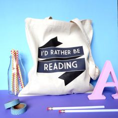 This adorable book tote bag is perfect literary gift for packing all your  beach reads this summer.