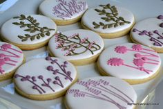 An assortment of flower designs on round cookies