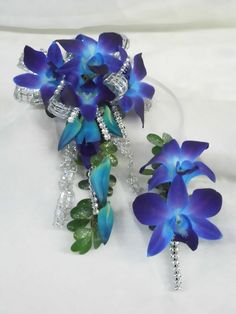 Prom flowers:  Upper arm wrist corsage of blue orchids and silver bling.