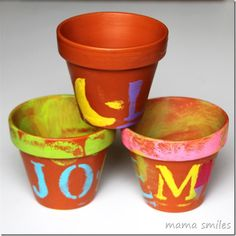 Child-painted terra cotta clay pots from Mama Smiles. Perfect for an herb garden or Mother's Day present.