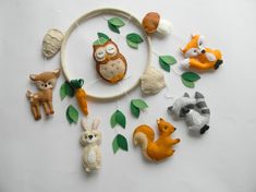 Custom Woodland nursery mobile. You can pick your colors and animals! This Woodland mobile is hand made from scratch, hand-cut, hand-sewn each item with quality wool felt and lightly filled. It is a great gift for baby shower gift, kid room decor, for adults who love to decorate in their home etc. The listing baby mobile includes 6 animals , mushroom, pine cone, carrot, acorn, leaves. The toys are all supported on a wooden hoop covered in beigefelt. Size, approximately: Wooden Hoop 8,6 (...