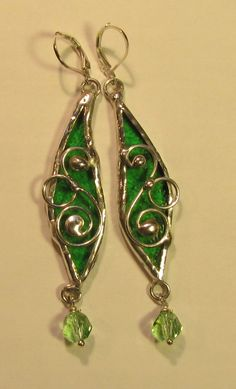 Free form glass earrings in brilliant apple green and soldered with Silvergleem.