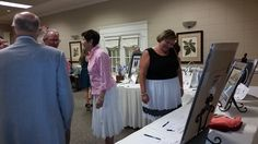 the audience peruses the silent auction items