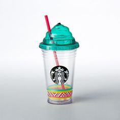 An acrylic Cold Cup with beach blanket art and a whipped cream-shaped lid. Part of the Beach Getaway Drinkware Collection.