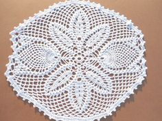 Handmade crochet doily color - white 100 % - cotton size - 11 inches ( 28 cm . ) X 10 inches ( 25 cm . )