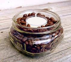 """I make these DIY coffee-scented candles by pouring beans (the cheaper, the better) into a small glass jar; just leave a quarter-inch of space on the top, then nestle a vanilla tealight in snugly. It smells like a fresh pot of vanilla coffee — even after the candles are out."" –Lisa Steele of Fresh Eggs Daily  - GoodHousekeeping.com"