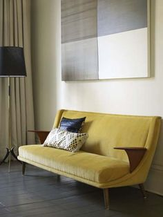yellow velvet couch.....such a cool shape
