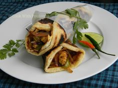 Chicken Kathi Rolls Ingredients: For paratha: 1.All-purpose flour: one cup. (for four egg chicken rolls) 2.Pinch of baking powder. 3.Pinch of salt. 4.Pinch of sugar. 5.Three tea spoon sunflower oil. 6.Water.  For roll stuffing: 1.Boneless chicken bites: 200 gm. 2.One large red onion  3.One green bell pepper 4.One pieces of lemon. 5.green chilies. 6.Chaat Masala, Red chili powder, Black pepper powder  7.One tea spoon ginger garlic paste. 8.One tea spoon curd. 9.Salt and sugar  10.Four eggs.