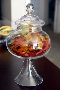 glass apothecary jar filled with fallen leaves from yard