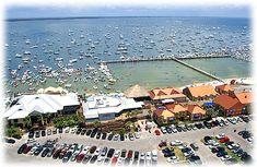 Pensacola Beach boardwalk: - Cactus Flower · - The Wine Bar - Hemmingway's - Hooter's - Surf Burger · - Papa's Pizza · - Flounder's -  Santa Rosa Sound - Pensacola Beach