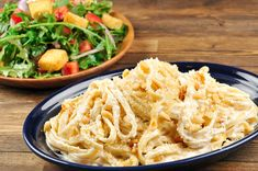 Fettuccine Alfredo with pine nuts and arugula salad