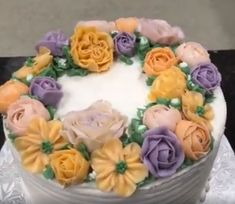 Have a look at this beautiful cake with #buttercream colorful flowers. Buy this cake from #ALittleCake and make your event more special and memorable. #cakes #weddingcakes #birthdaycakes