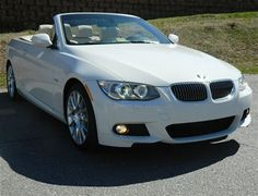 2013 Alpine White BMW 328i Convertible. Talk about gorgeous!!!! I need one of these when I get older!!!
