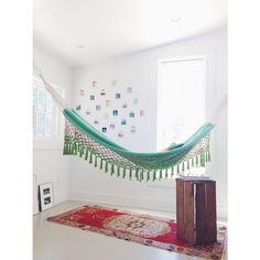 Pin for Later: Keep Swinging! How to Bring Your Hammock Indoors  An eclectic use of colors and wall art makes for a comfy lounging area in the corner of this room. Source: Instagram user gigaram