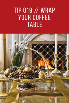 Tip 019 // Wrap Your Coffee Table 🎁😍 Transform a coffee table into a wrapped Christmas present by crisscrossing strands of ribbon over the top and sides for a giftlike effect. Silver family heirlooms add to the sparkly decorating theme.