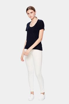 $35 -100% Tencel The Black U-neck Tee features a dropped neckline and dolman sleeves. Clean by design, Tencel is made from recycled wood cellulose and is more absorbent than cotton, extraordinarily soft and cooler than linen.