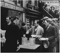 Men lined up in a bread line at a Mission.   Depression: Breadlines: long line of people waiting to be fed: New York City: in the absence of substantial government relief programs during 1932, free food was distributed with private funds in some urban centers to large numbers of the unemployed.     http://history1900s.about.com/library/photos/blygd8.htm
