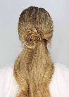 The rosette embellished half down ponytail