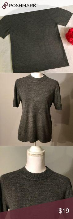 "Sag Harbor grey sweater blouse Sag Harbor grey sweater blouse. Dark grey, short sleeve sweater top. Ribbed neckline, hem, and sleeves. Stretchy material. Size medium. EUC, excellent used condition. Measurements taken laid flat. 16 ½"" shoulder width, 19"" bust, 25 ½"" length. Sag Harbor Sweaters Crew & Scoop Necks"
