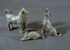 BRONZE TOYS OR VOTIVE OBJECTS (BULL, DOGS) / ROMAN.Roman sculpture. 1st–3rd century AD:  Animal figurines (bull, dogs).  Bronze toys or votive objects from Ostia, Italy.  Museo Ostiense, Ostia, Italy.