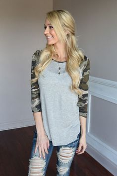 3/4 Sleeve Camo top. True to size. Material: 95% Rayon 5% Spandex Model is 5'5'' a size 0 wearing a small. Product Sizing Chart Size Bust Hip Length Waist Small 36 N/A 27 N/A Medium 38 N/A 27 N/A Larg