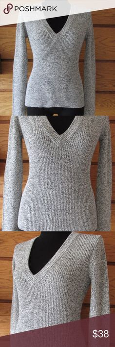 """Theory V-Neck Sweater Brand: Theory Size:  Large  Measurements (laying flat and unstretched) Chest: 18.5"""" Back of Collar to Bottom Hem: 26"""" Sleeve: 25""""  Description:  Nice v-neck style sweater from Theory Neutral colors in light gray and black tween design Heavy knit is great for cooler weather Versatile piece - great staple for any wardrobe Excellent pre-owned condition Theory Sweaters V-Necks"""