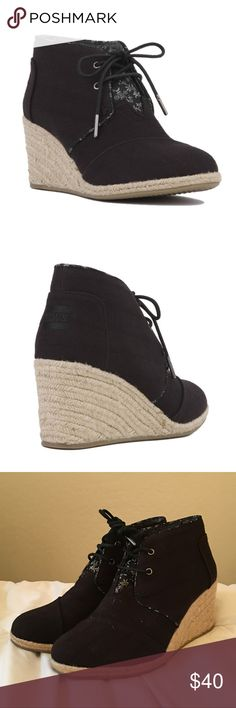 NEW TOMS DESERT ROPE LINED WEDGE BOOTIE - BLACK Brand new Desert wedges with roped lined wedge heels! Great black canvas color. The tongue of the booties has the cutest subtle floral design that just makes these everything you need! If you have any toms, you know how comfortable these are! Get them at this hot off season price while you can! Let me know if you have any questions! Toms Shoes Ankle Boots & Booties