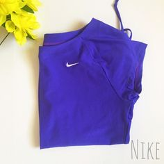 Nike dry-fit  Body: 85% polyester 13% spandex. Mesh (upper back) 86% polyester 14% spandex  Excellent condition! No sign of wear! (The color is purple/blue!) Nike Tops