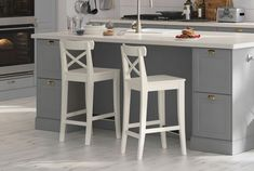 IKEA bar stools INGOLF white in a BODBYN grey kitchen