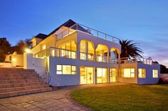 Located in the heart of Camps Bay, Cape Town, this six bedroom vacation rental is teeming with charm.