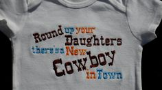Cowboy Onesie  Embroidered Round up your Daughters There's a New Cowboy in Town Baby Boy Clothes. $16.50, via Etsy.