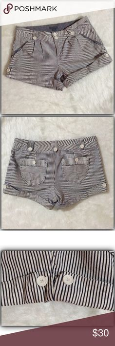 "A/X Armani Exchange short size 8 100% cotton. Cuffed with adorable leg detail. Buttons back pockets are super cute. Rise 9"". Inseam 3"". Waist measured flat one side 16"": A/X Armani Exchange Shorts"