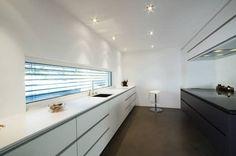 Einfamilienhaus im Schweizer Mittelland: moderne Küche von Unica Architektur AG