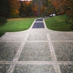 Driveway created with European Sandstone and Belgian Porphyry cobblestone cubes.