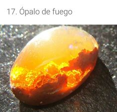 This is the Fire Opal,which was found in Mexico.The look inside the Opal looks like a fiery sunset or sunrise sky. Sunset Fire Opal, Opal Edelstein, Colors Of Fire, Types Of Opals, Fallen London, Above The Clouds, Mineral Stone, Galaxy Art, Opal Gemstone
