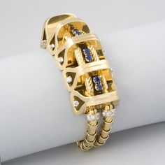 French Retro Gold, Diamond and Sapphire Bracelet by Gubelin.  Available exclusively at Macklowe Gallery.