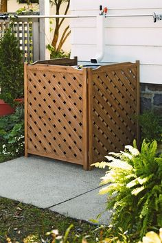 Lattice screen for your recycling bins & garbage cans. rain barrel, water pump, pool equipment, AC unit, etc. Decor, Outdoor Decor, Trash Cans, Lawn And Garden, Front Yard, Backyard Projects, Air Conditioner Hide, Garden Supplies, Lattice Screen