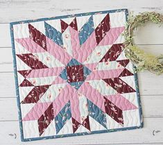 "The Chrysanthemum Mini Quilt Pattern is a paper pieced mini pattern and it finishes at around 14"" square. Mini Quilt Patterns, Pdf Patterns, Pattern Blocks, Free Pattern, Easy Quilts, Mini Quilts, Scrappy Quilts, Fabric Stars, Doll Quilt"