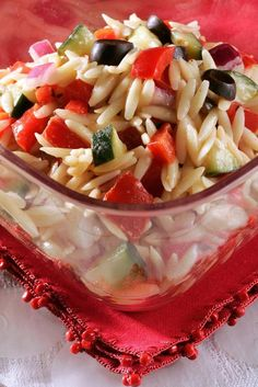 This Greek orzo salad makes for a hearty and healthy tailgating side dish