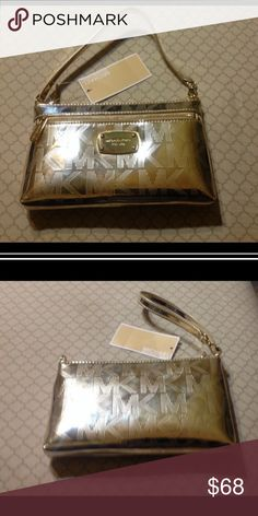 """Michael KORS large wristlet NWT Beautiful Michael KORS pale gold metallic wristlet. Handle adjusts so it can be held as a handbag as well. exterior has a side pocket with a zip closure.  Interior has a slip pocket on one side and 4 card slots on the other with a zip top closure. dimensions are 7.75"""" x 4.75"""" x 1"""".  NWT. NO TRADES Michael Kors Bags Clutches & Wristlets"""