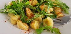 Vegan butternut squash gnocchi topped with arugula, paprika and olive oil!
