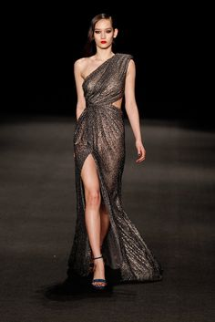 The Fall '15 Gowns That Should Walk Right Off the Runway Onto the Red Carpet: Most of the time when we spot a gorgeous dress on the runway, we dream we're wearing it.