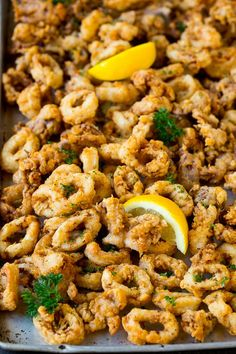 This fried calamari recipe is tender pieces of squid soaked in buttermilk, then coated in seasoned flour and deep fried to golden brown perfection. A quick and easy appetizer option that& Hot Appetizers, Quick And Easy Appetizers, Seafood Appetizers, Appetizers For A Crowd, Appetizer Dinner, Fish Dishes, Seafood Dishes, Seafood Recipes, Pasta Recipes