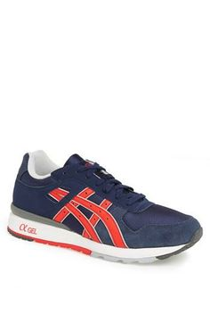 Blue and red asics running shoes