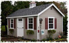 Tan house & maroon shutters
