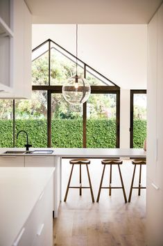 Scandinavian inspired Scandi House created by Lifespaces Group to harness minimalist and scaled back beauty of the style in Australia Outdoor Living Areas, Living Spaces, Bar Seating, Geometric Form, Built In Wardrobe, Large Bedroom, House And Home Magazine, Large Windows, Bars For Home